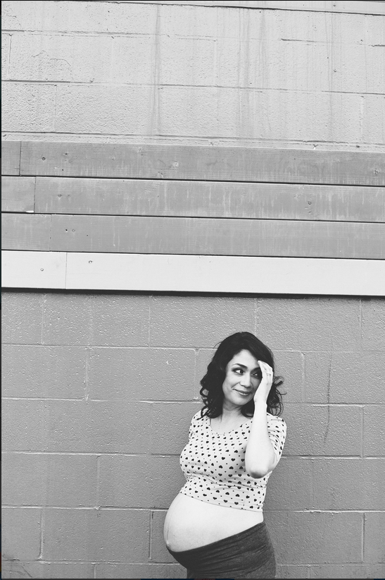 B and W Blue Wall Touching Hair