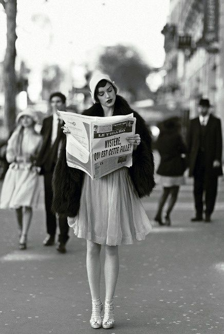 black-and-white-woman-newspaper